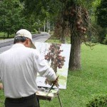 An artist painting the Cannonball tree at Penang Botanical Garden