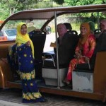 Malaysian visitors waiting for a tram tour of Putrajaya Botanical Garden