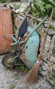 The tools of a gardener's trade at Penang Botanical Garden - an umbrella, wheelbarrow and a homemade broom